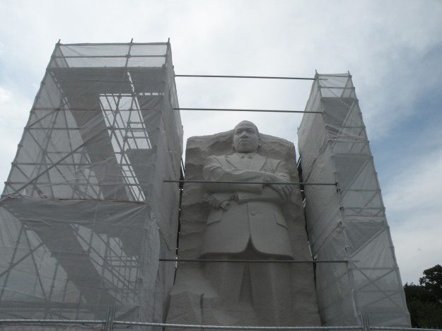 Scaffolding flanks the massive statue as they work to complete the updates
